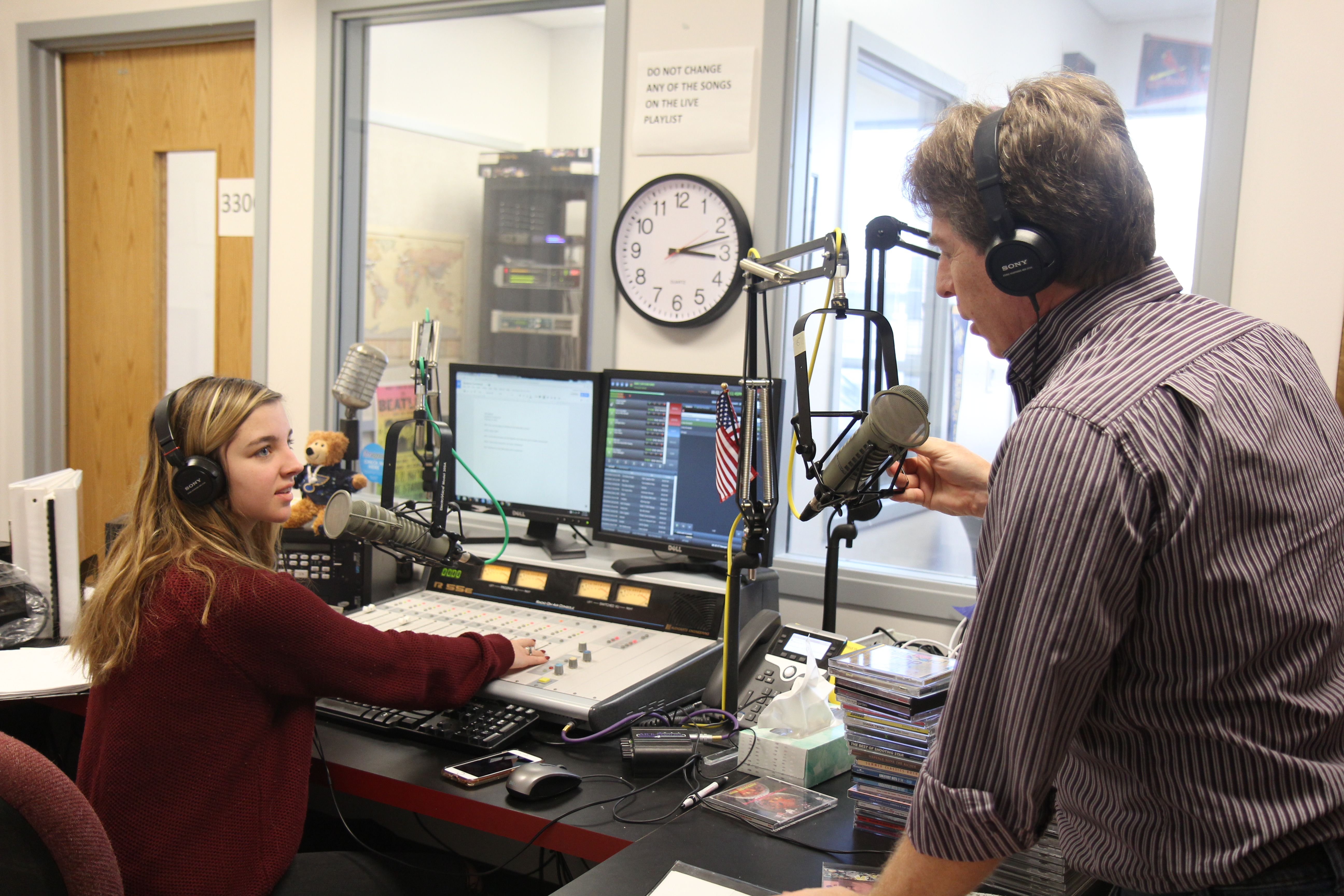 MIPA 2018 Journalism Teacher of the Year works with a student in the FM radio station he created for Rockwood Summit High School. Submitted photo.