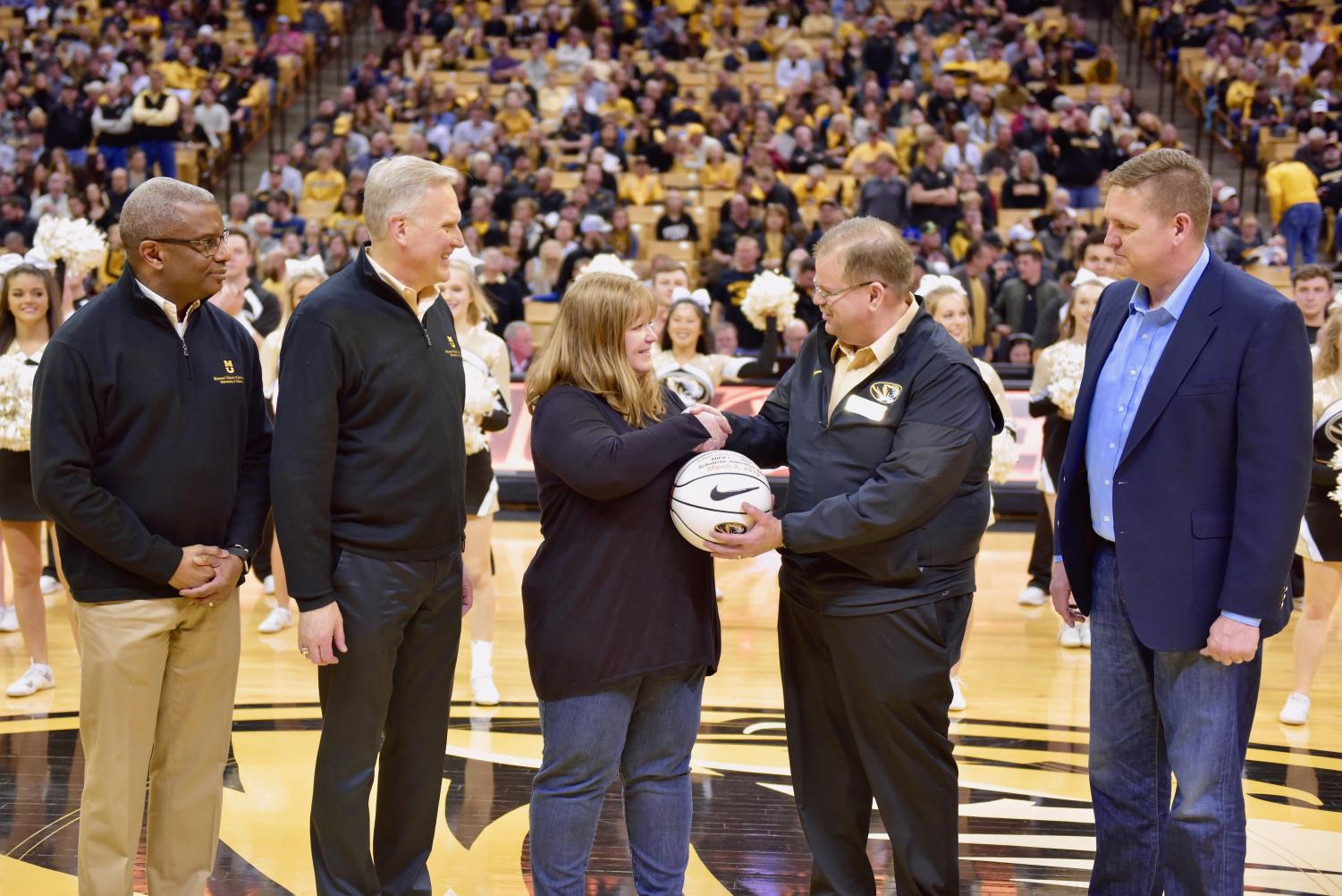 Mizzou+Chancellor+Alexander+Cartwright+presents+a+game+ball+to+Christina+Geabhart%2C+president+of+MIPA+Missouri+Interscholastic+Press+Association%2C+during+the+Mizzou+Men%27s+Basketball+game+Saturday+at+Mizzou+Arena.+Nearly+200+journalism+and+yearbook+advisers+and+their+students+were+at+the+game+for+Scholastic+Journalism+Day%2C+which+celebrated+high+school+journalism+programs+across+Missouri.+Geabhart+is+the+journalism+teacher+at+Oak+Park+High+School+in+North+Kansas+City+Schools.%0A%0ALeft+to+right%3A+Associate+Professor+Ron+Kelley%2C+co-executive+director+of+MIPA%3B+Missouri+School+of+Journalism+Dean+David+Kurpius%3B+Geabhart%3B+Cartwright%3B+and+Keith+Hughey%2C+an+executive+with+Walsworth+Yearbooks.+%23MissouriMethod+%23MizzouMade+National+Scholastic+Press+Association+Journalism+Education+Association