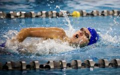 Swimming the 400 freestyle relay, freshman Will Cottle breathes during his race at the St. Peters Rec Plex, Oct. 5.