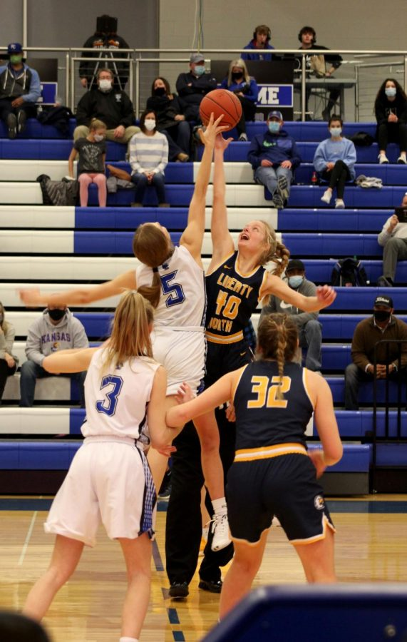 Sophomore Marianna Tomc reaches for the ball and hopes to pass it off to her teammate, sophomore Kaitlin Davis on Dec. 19 against Liberty North. This was a big game for the lady jays because they were playing their all time rival.