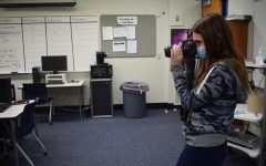 MIPA SJOY winner, senior Abby Prywitch, Parkway Central High School, takes a photo.