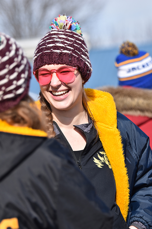 Hundreds of students make their way to the shores of longview beach in support of Special Olympics. Senior Presley Davis sprints through the ice cold water for the last time.