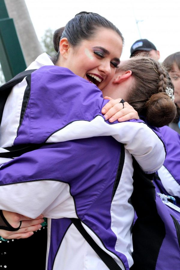 After learning they would perform in the kick finals at the United Dance Associations Nationals Feb.1 in Orlando, Florida, seniors Caroline Hunter and Chandler Rawson hug and celebrate with their teammates. The team placed fourth in the nation in the large kick category and tenth in the large pom category.
