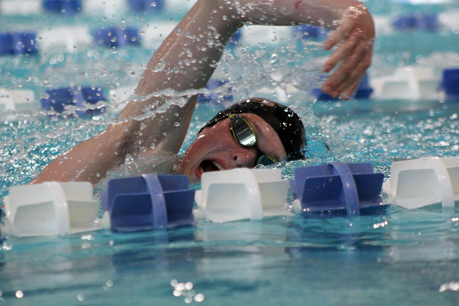 Sophomore Andrew Nelson swims the 500-yard freestyle at Gladstone Community Center on Oct. 1.
