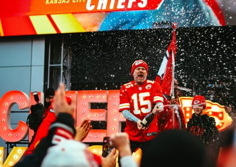 "SUPER BOWL BOUND  At the Power and Light District in downtown Kansas City, a hypeman and the crowd of fans celebrate the Chiefs winning the AFC Championship on Jan. 19. The hypeman waved a Chiefs flag and sprayed a champagne bottle while screaming, ""We"