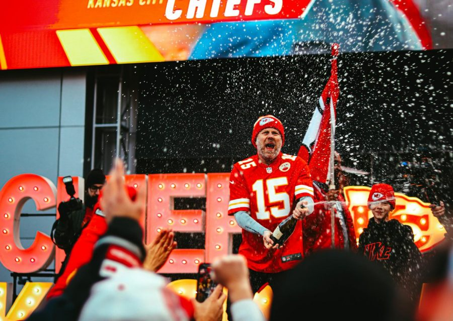 SUPER BOWL BOUND  At the Power and Light District in downtown Kansas City, a hypeman and the crowd of fans celebrate the Chiefs winning the AFC Championship on Jan. 19. The hypeman waved a Chiefs flag and sprayed a champagne bottle while screaming,