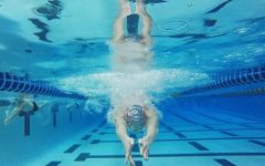 On Nov. 5 while at practice, Ilya Balyuk (12) finishes off his breaststroke lap by diving under the water.