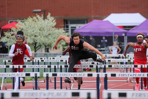 Jumping over the hurdle, senior Bryce Kazmaier races during the 110 meter hurdles at the Timberland Wolf Pack Invite, April 10. Kazmaier won with a time of 14.69 and set a new personal record.